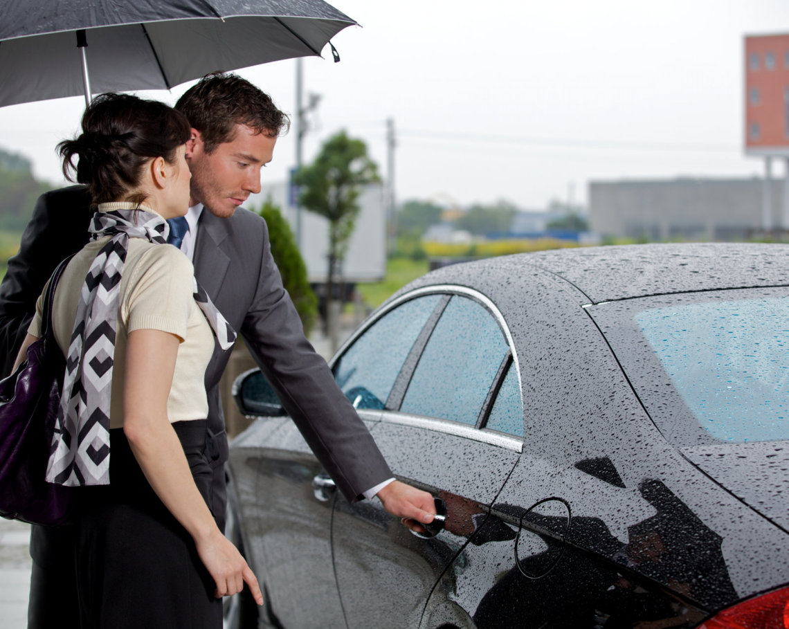 man opening a car door for a woman